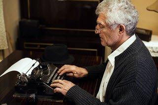 Typing at typewriter small